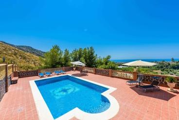Ferienhaus mit Terrasse mit Meerblick