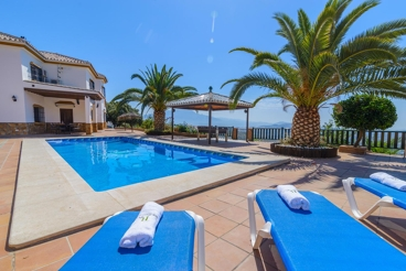 Villa with enormous terrace, children playground and outdoor kitchen