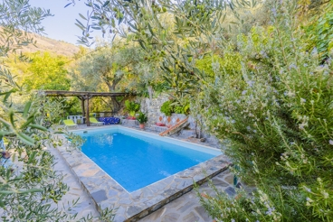 Villa with fireplace and a fairy-tale garden - for four people in Lanjarón